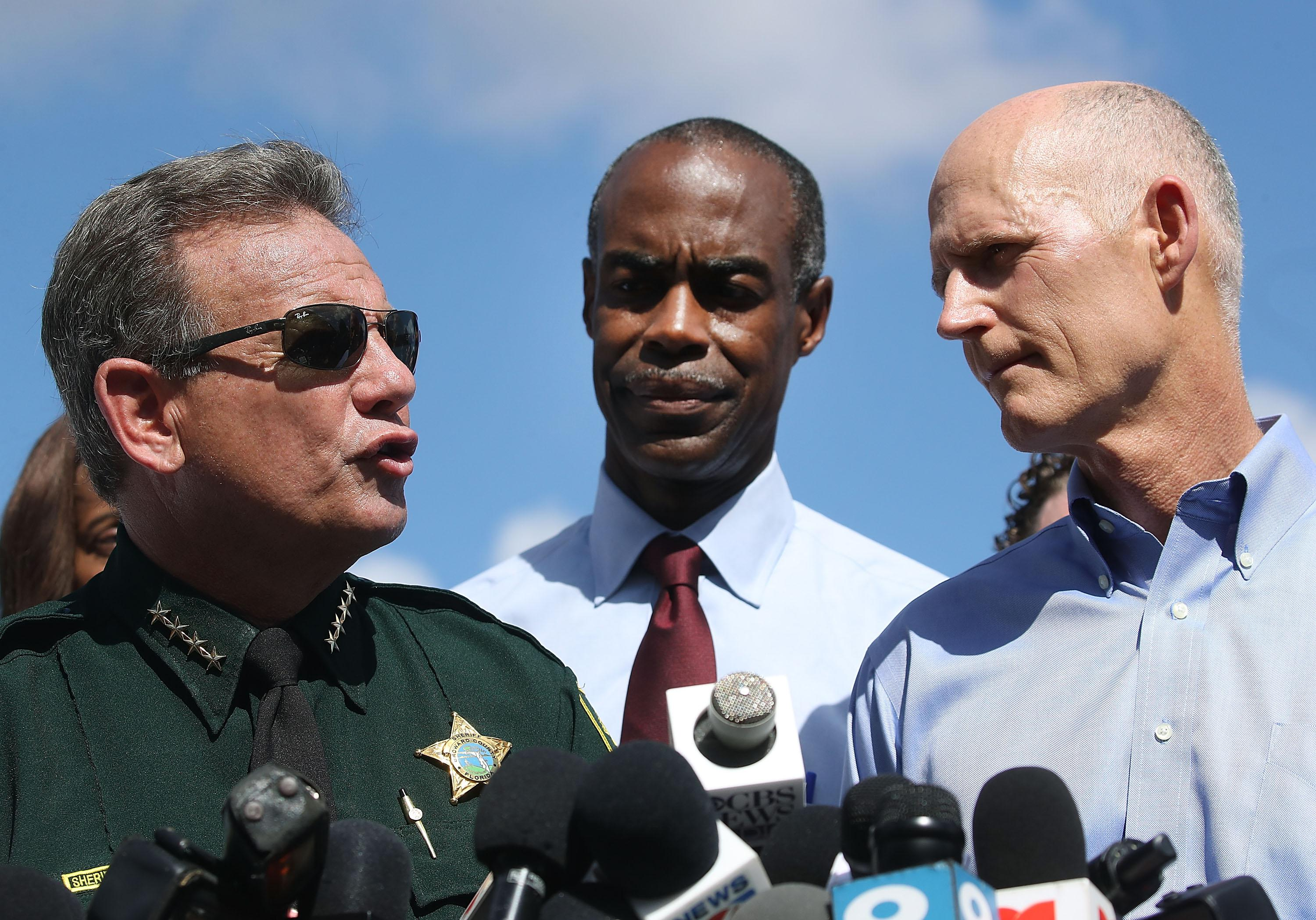 Florida Governor Rick Scott (R), Broward County Superintendent of Schools, Robert W. Runcie (C) and Broward County Sheriff, Scott Israel (L) on February 15, 2018 in Parkland, Florida.