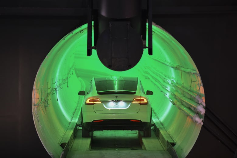 A modified Tesla Model X electric vehicle enters a tunnel.