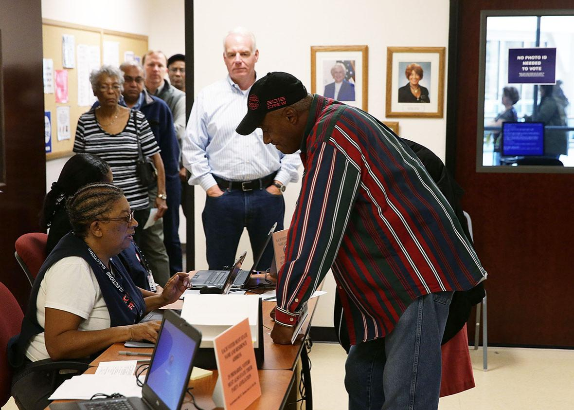 Voters wait in line for check in to cast their ballots during early voting for the 2016 general election at Forsyth County Government Center October 28, 2016 in Winston-Salem, North Carolina.