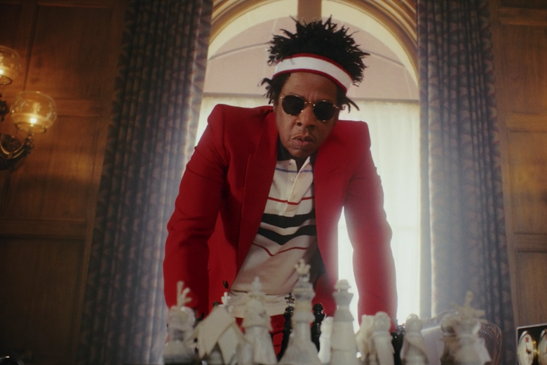 Jay-Z hunches over a chessboard.