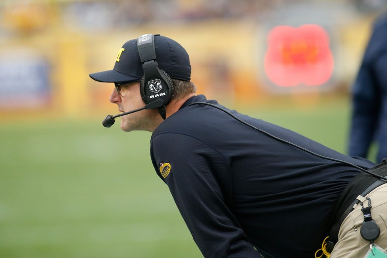 TAMPA, FL - JANUARY 1:  Head coach Jim Harbaugh of the Michigan Wolverines looks on from the sidelines during the second quarter of the Outback Bowl NCAA college football game against the South Carolina Gamecocks on January 1, 2018 at Raymond James Stadium in Tampa, Florida. (Photo by Brian Blanco/Getty Images)