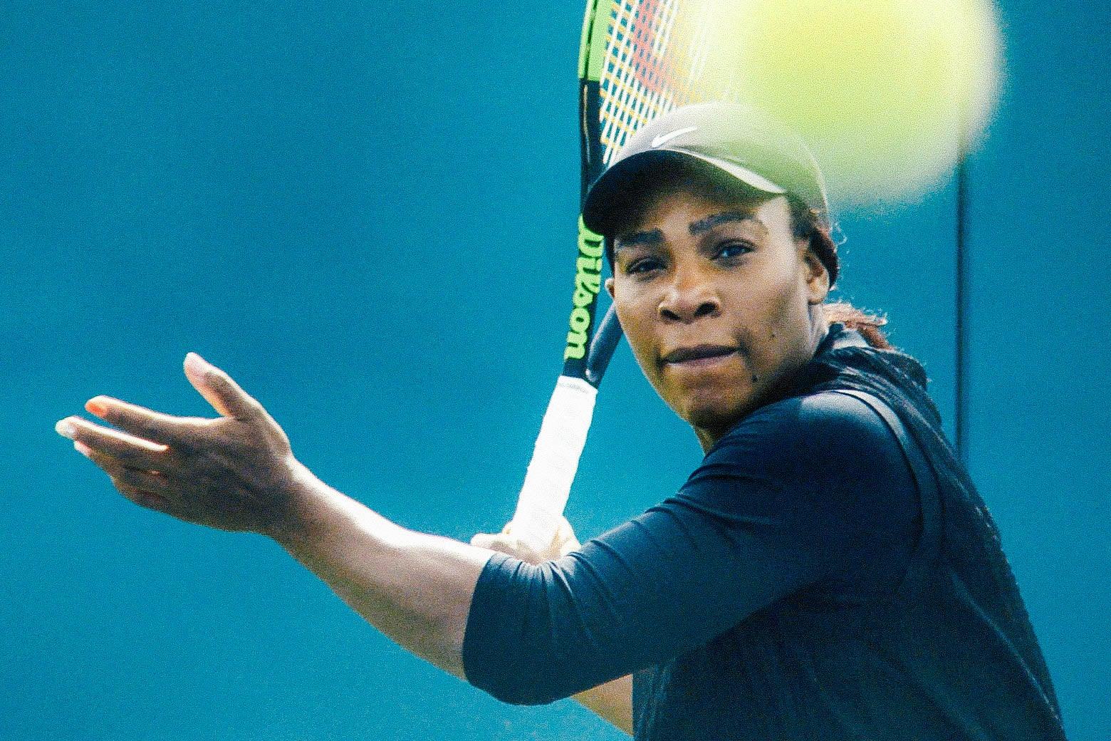 Serena Williams swings a tennis racket.