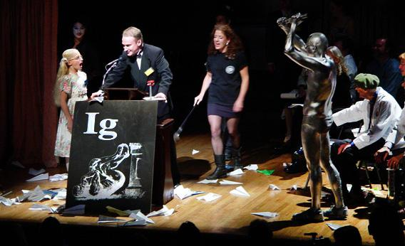Miss Sweetie Poo confronts Charles Paxton at the 2002 Ig Nobel Prize ceremony at Harvard University.