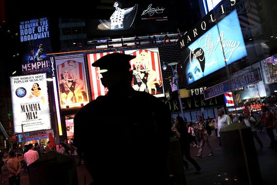 A New York City police officer pictured stands watch in Times Square.