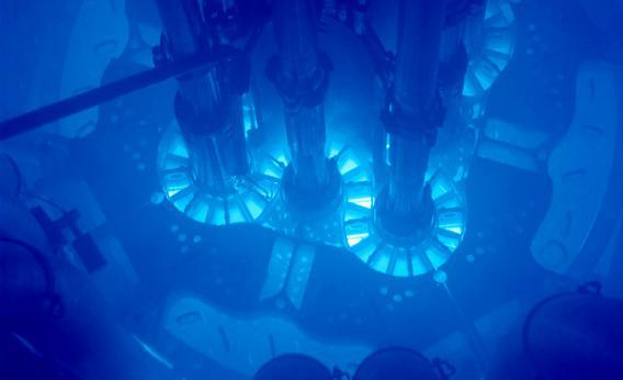 Samples from Idaho National Laboratory's Advanced Test Reactor (ATR) core will be sent to Argonne's ATLAS particle accelerator for analysis to learn the characteristics of the nuclear material. Powered up, the fuel plates can be seen glowing bright blue. The core is submerged in water for cooling.