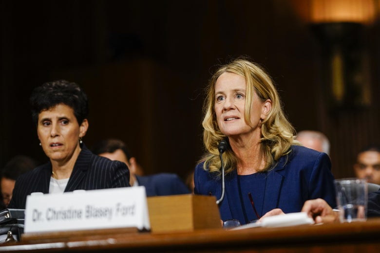 Christine Blasey Ford sits before the committee, appearing alert; her lawyer, Debra Katz, sits nearby