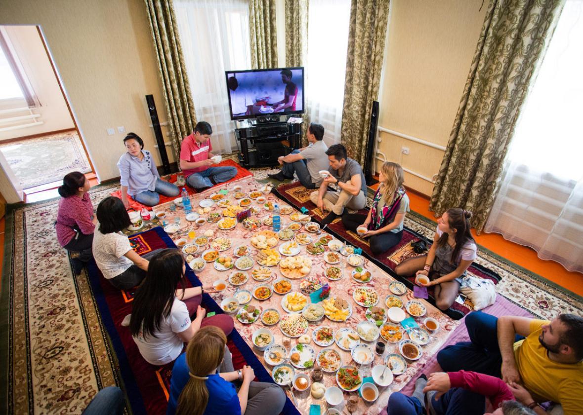 Tourists enjoying Dungan lunch with Hamida and Karim