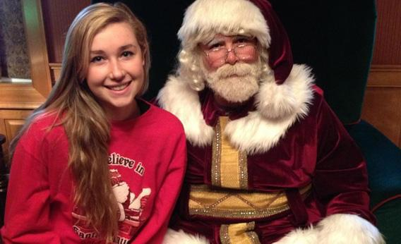 Santa Claus, aka Mick Foley, and his daughter.