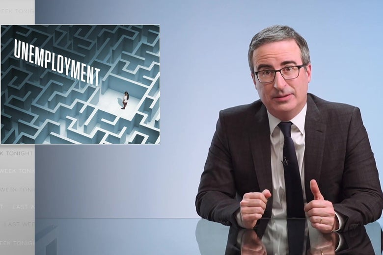 "John Oliver sits at his glass anchorperson desk, in front of a graphic reading ""Unemployment,"" depicting a person trapped in a maze."