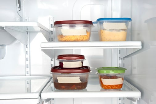 Picture of the inside of an office fridge, Tupperware with labels.