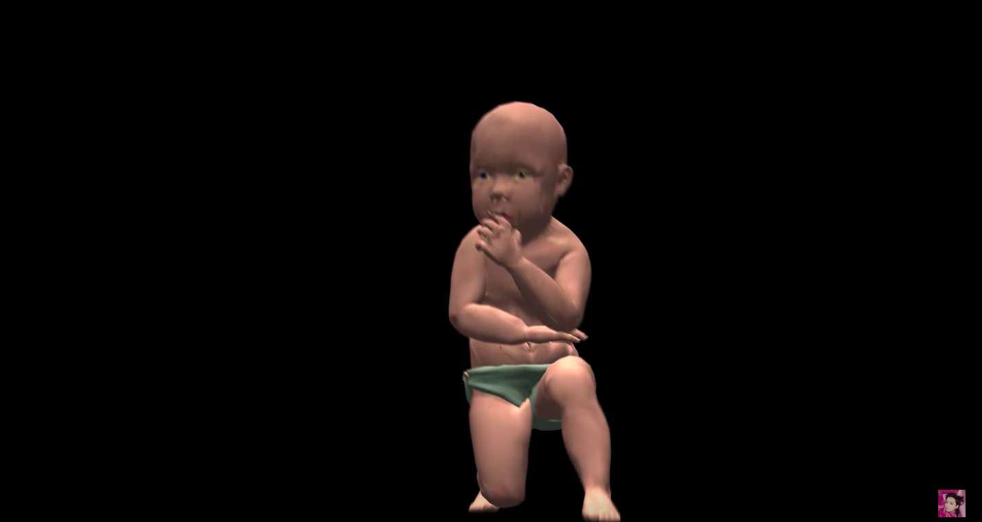 Computerized baby kneeling and dancing.