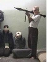 Hostages with a terrorist. Click image to expand.