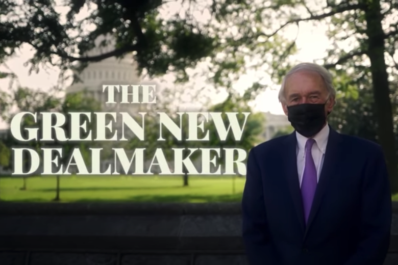 "Ed Markey, wearing a mask, standing in front of the Capitol with the text ""The Green New Dealmaker."""