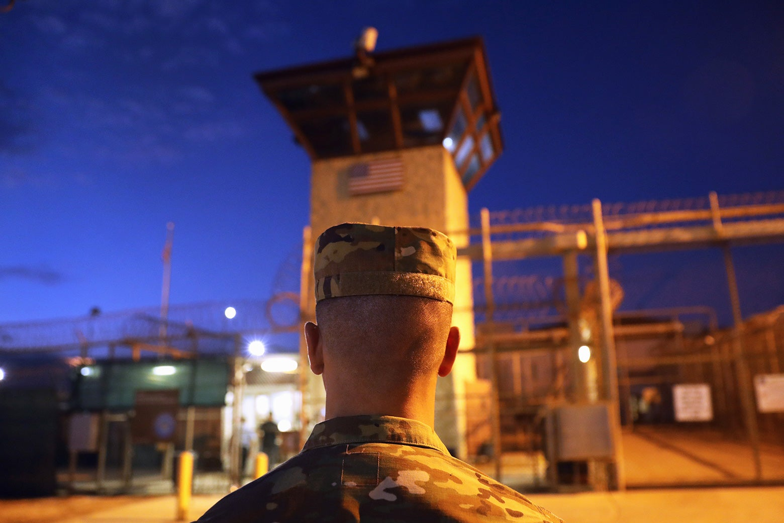 A U.S. Army soldier stands outside the entrance of the detention center at the U.S. Naval Station at Guantanamo Bay, Cuba, on Oct. 22, 2016.