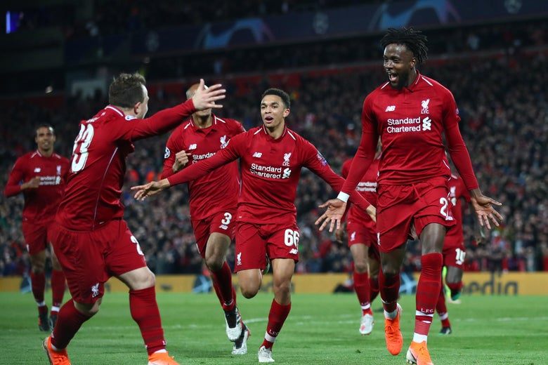 LIVERPOOL, ENGLAND - MAY 07:  Divock Origi of Liverpool (27) celebrates as he scores his team's fourth goal with team mates during the UEFA Champions League Semi Final second leg match between Liverpool and Barcelona at Anfield on May 07, 2019 in Liverpool, England. (Photo by Clive Brunskill/Getty Images)