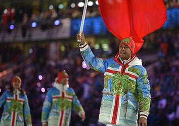 Tonga's flag bearer, luger Bruno Banani leads his national delegation during the Opening Ceremony of the Sochi Winter Olympics at the Fisht Olympic Stadium on February 7, 2014 in Sochi.