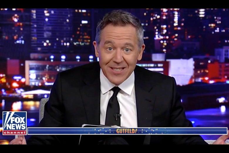 Screengrab of Greg Gutfeld grinning on his show