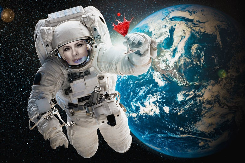 Kim Cattrall in an astronaut's suit in space.