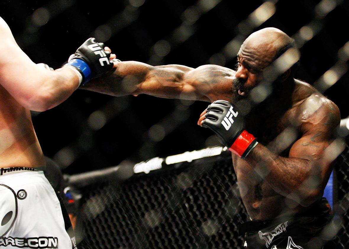 Kimbo Slice punches Matt Mitrione in their heavyweight bout at UFC 113 at Bell Centre on May 8, 2010 in Montreal, Quebec, Canada.