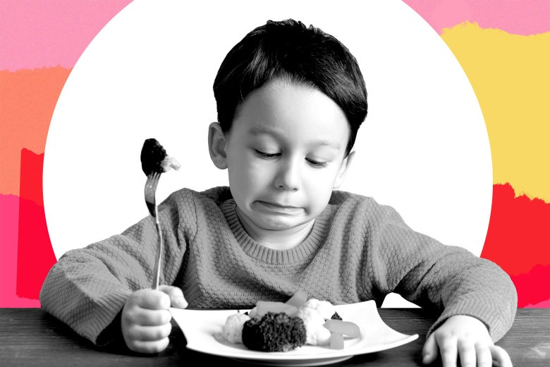 A kindergarten-aged child looking at his dinner plate in disgust.