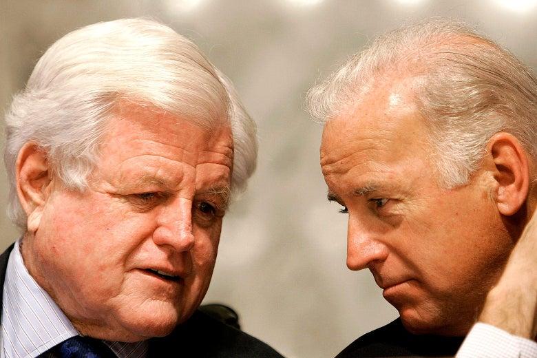 Kennedy speaks to Biden, who is leaning in