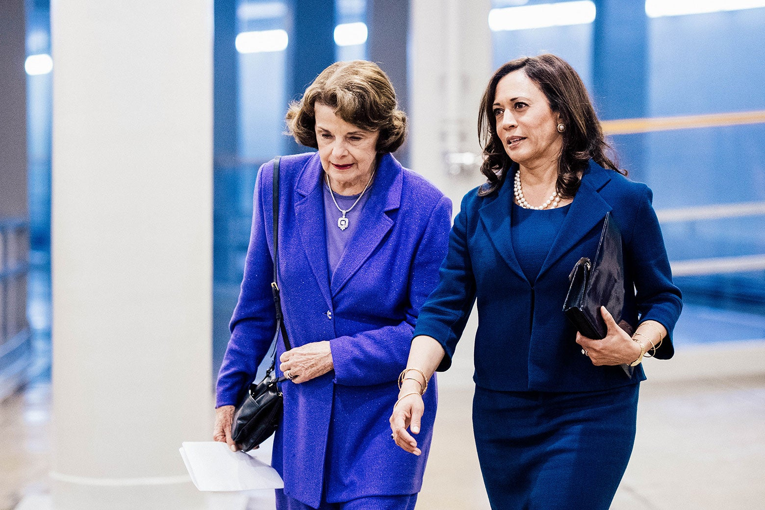 Dianne Feinstein and Kamala Harris walk side by side as they arrive at the Capitol.