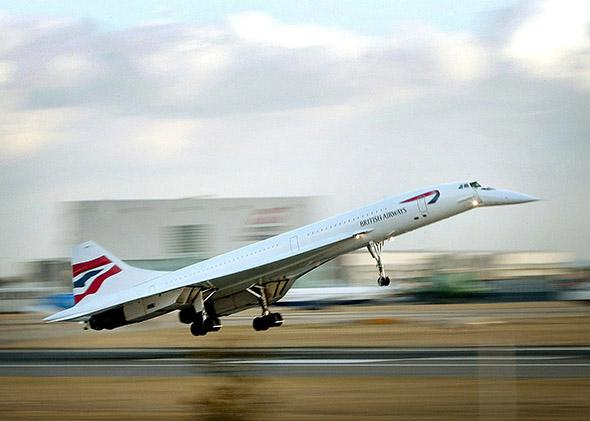 The last British Airways passenger Concorde flight lands at London's Heathrow Airport from New York on Oct. 24, 2003.