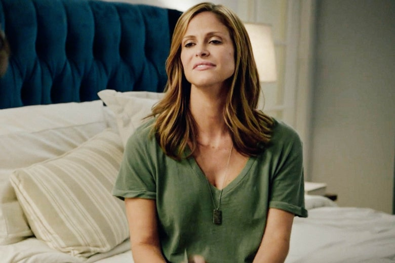 Andrea Savage sits on a bed in I'm Sorry.