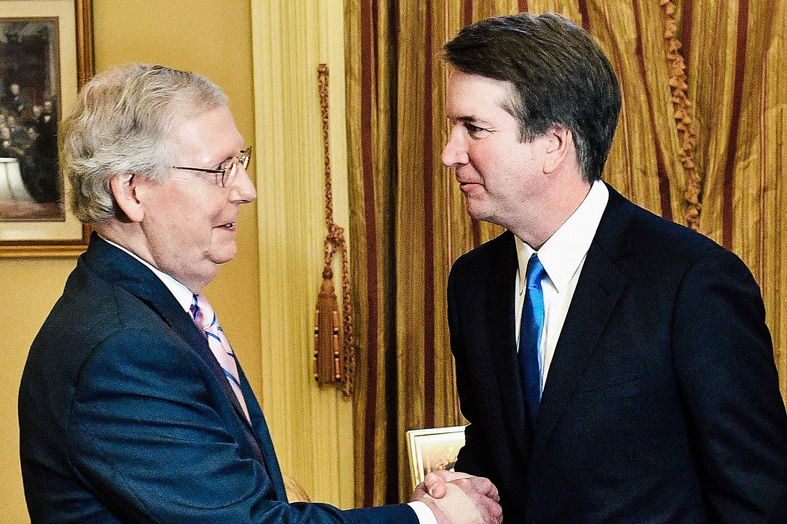 Sen. Mitch McConnell shakes hands with Judge Brett Kavanaugh in McConnell's D.C. office on July 10.