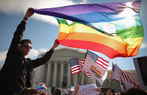 Eric Breese (L) of Rochester, New York, joins fellow George Washington University students and hundreds of others to rally outside the Supreme Court during oral arguments in the second of two cases the Court is hearing about same-sex marriage on March 27, 2013 in Washington, DC.