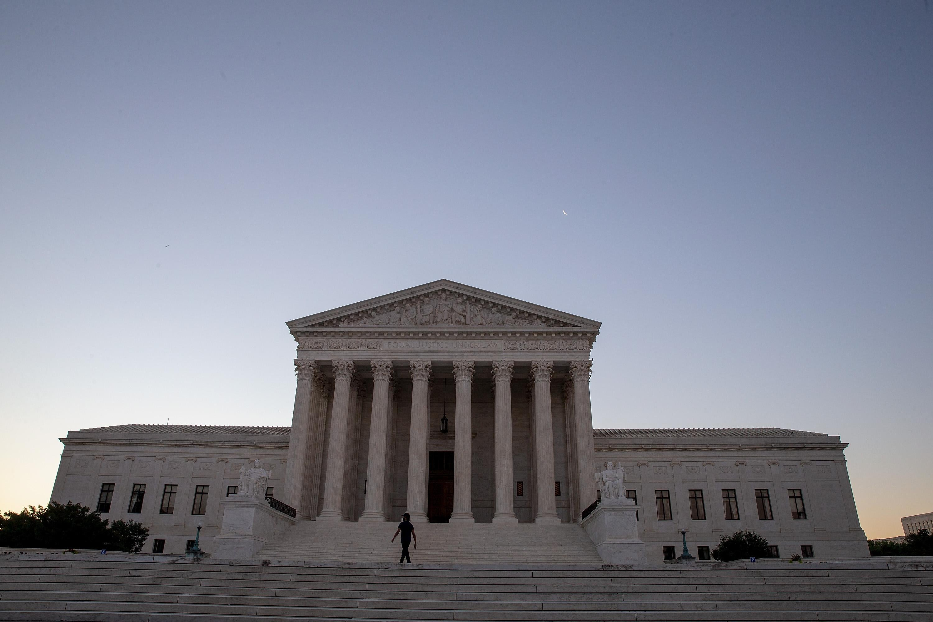 The Supreme Court building at sunrise.