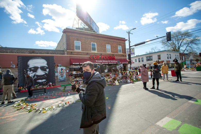 A man stands in George Floyd Square on Tuesday.