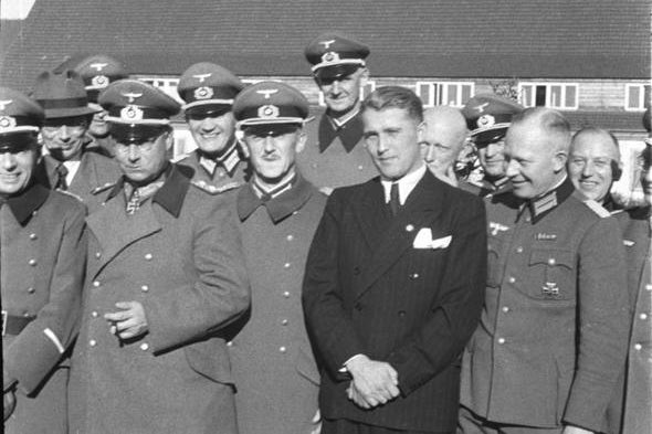 Von Braun standing with a bunch of Nazis in uniform