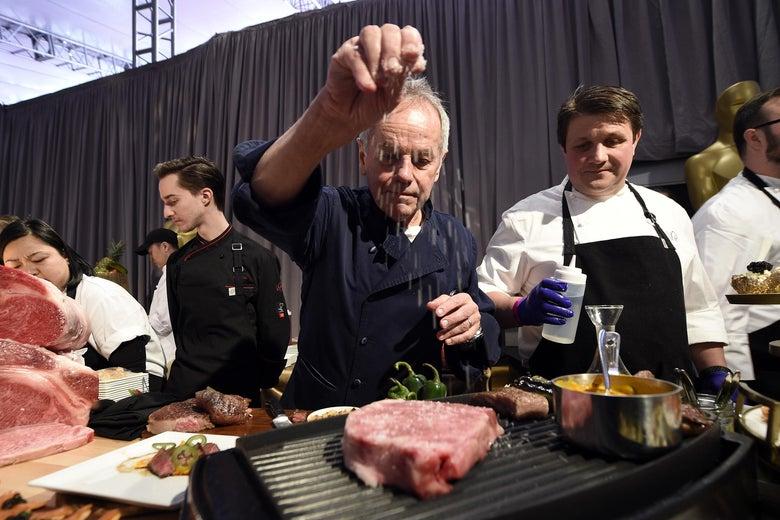 Master Chef Wolfgang Puck sprinkles salt on a Miyazaki Wagyu Beef.