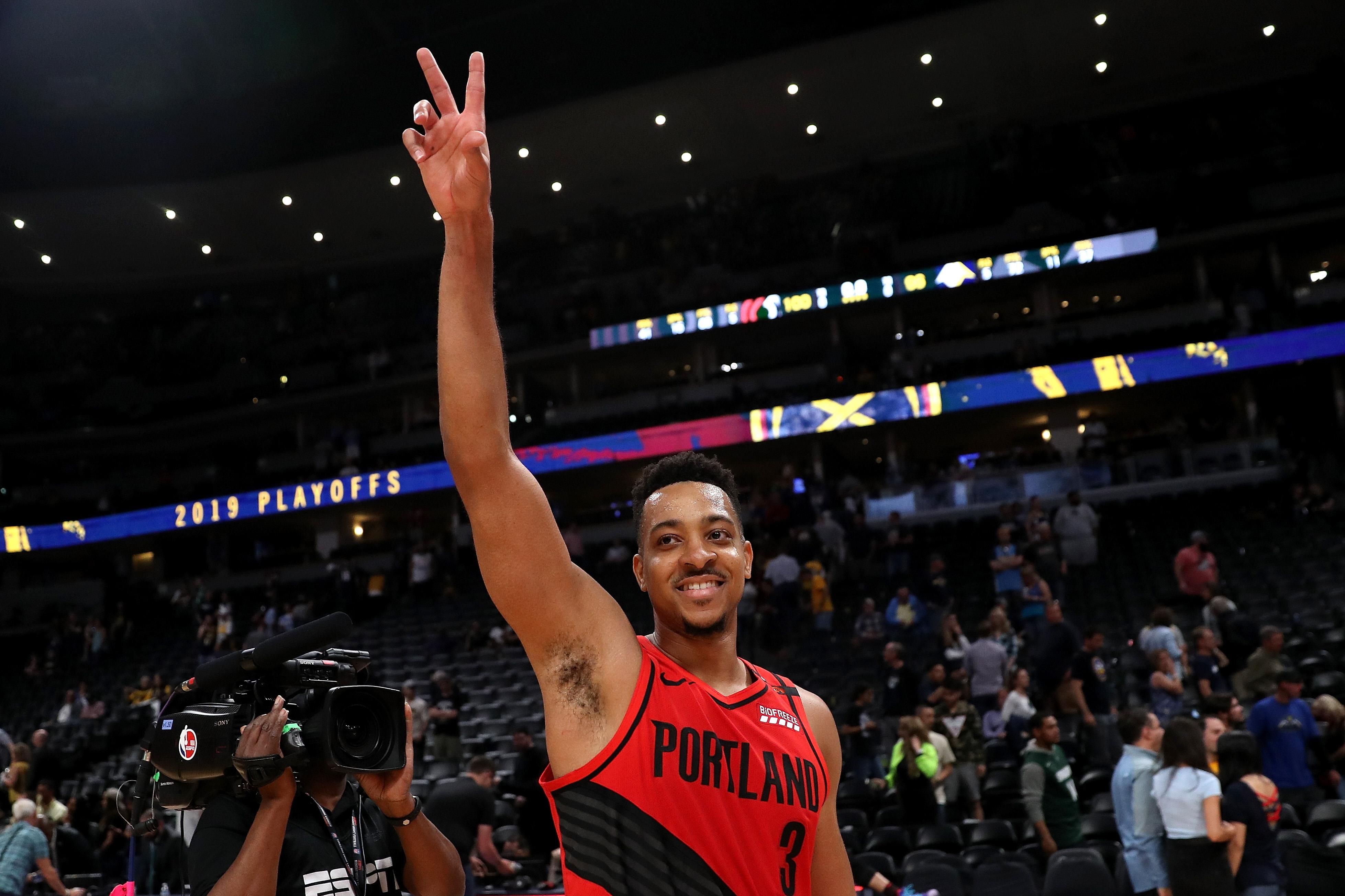 DENVER, COLORADO - MAY 12: CJ McCollum #3 of the Portland Trail Blazers celebrates their win against the Denver Nuggetts during Game Seven of the Western Conference Semi-Finals of the 2019 NBA Playoffs at the Pepsi Center on May 12, 2019 in Denver, Colorado. NOTE TO USER: User expressly acknowledges and agrees that, by downloading and or using this photograph, User is consenting to the terms and conditions of the Getty Images License Agreement. (Photo by Matthew Stockman/Getty Images)