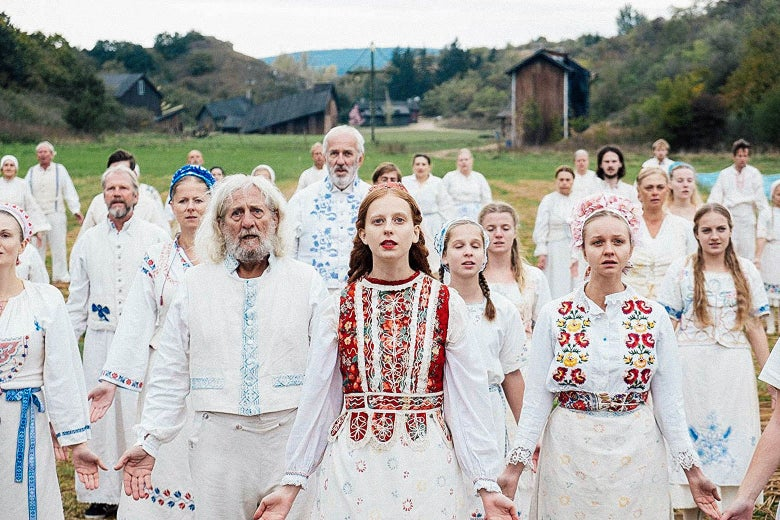 Still from Midsommar featuring some very dazed-looking members of the Harga