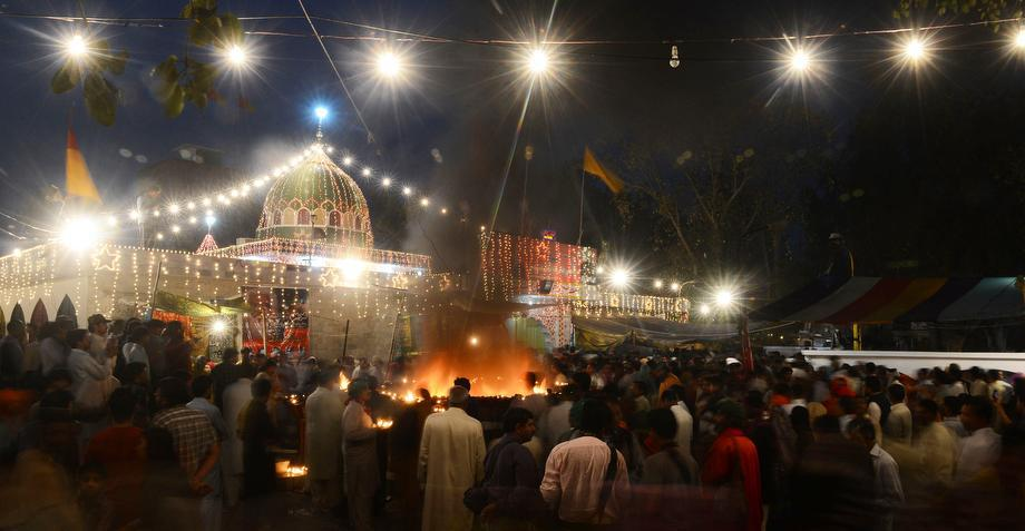 Pakistani devotees gather at the shrine of Sufi saint Hazrat Shah Hussain, popularly known as Madhu Lal Hussain, on March 30, 2013 in Lahore.