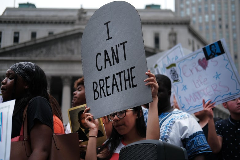 """A protester in New York holds a sign that says """"I can't breathe."""""""