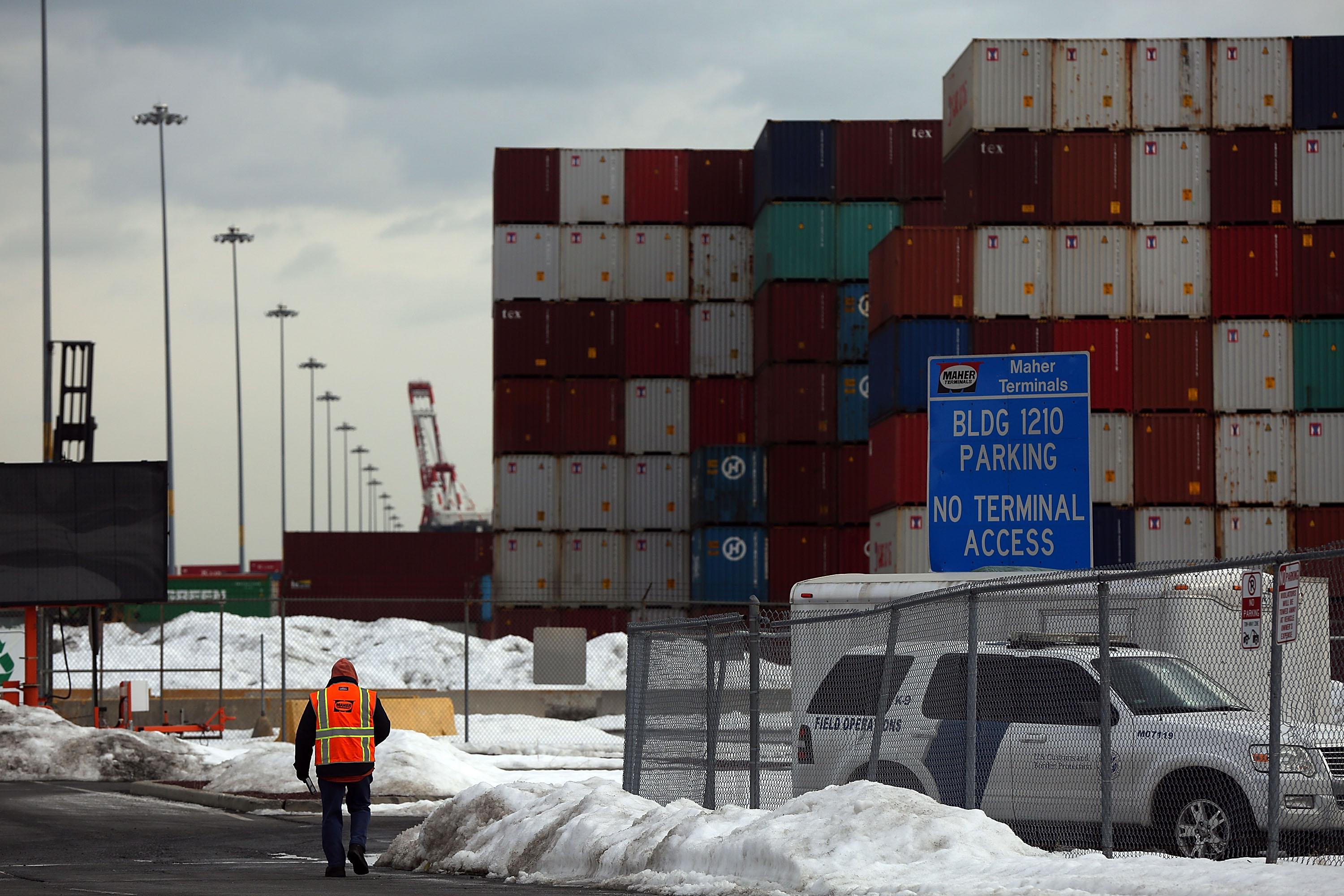 Shipping containers are stacked at the Port of Newark.