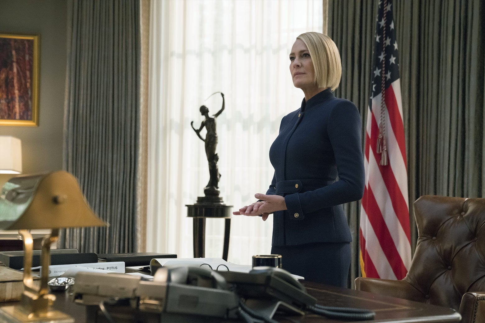 Robin Wright as Claire Underwood, standing in the Oval Office.