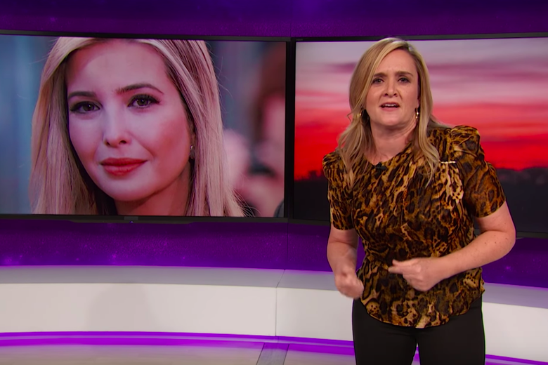 Samantha Bee stands in front of a graphic of Ivanka Trump's face