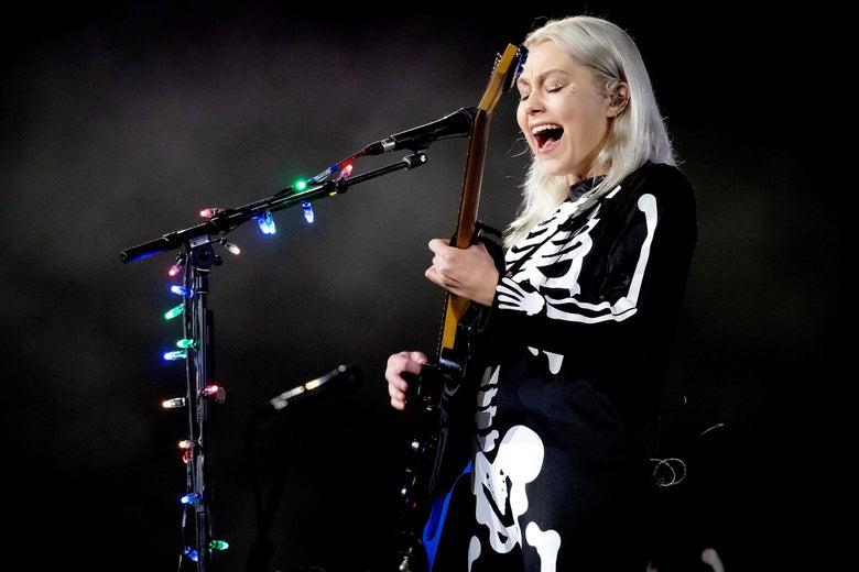 Phoebe Bridgers in her signature skeleton suit performing.