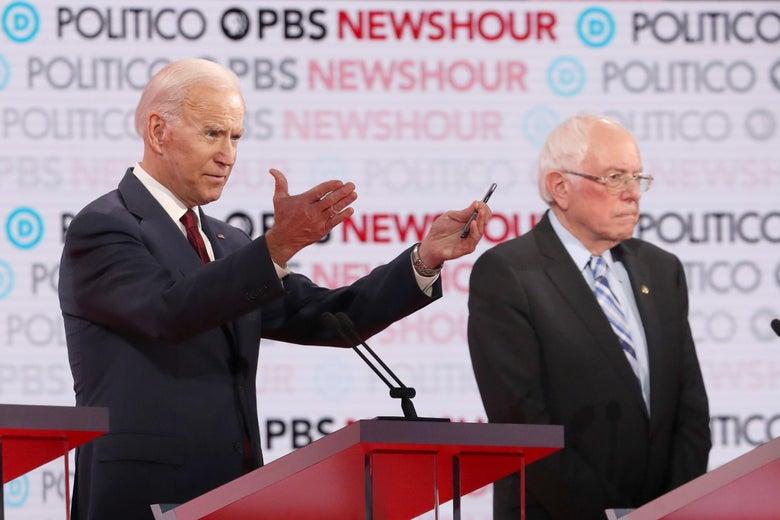 Former Vice President Joe Biden gestures as Sen. Bernie Sanders (I-VT) listens during the Democratic presidential primary debate at Loyola Marymount University on December 19, 2019 in Los Angeles, California.