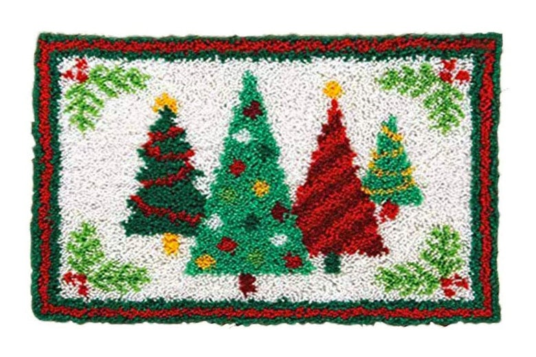 A rug with Christmas trees on it.