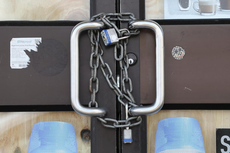 Chains and a lock wrapped around door handles.