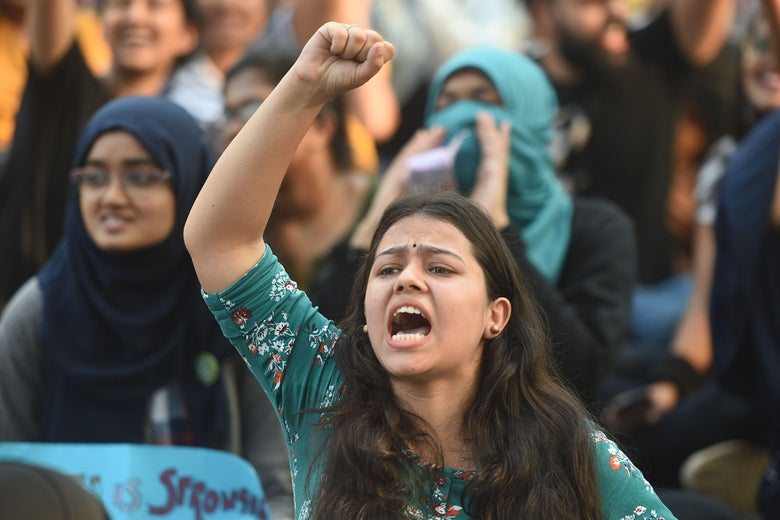 A female protester shouts at a demonstration in Mumbai.
