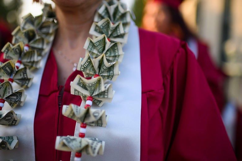 A graduating student wears a money lei, a necklace made of U.S. dollar bills, at the Pasadena City College graduation ceremony.