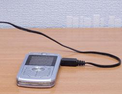 A cell phone charging.