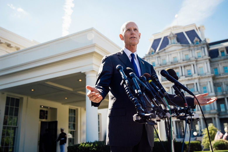 Florida Gov. Rick Scott speaks to reporters following his meeting with President Donald Trump at the White House on Sept. 29.