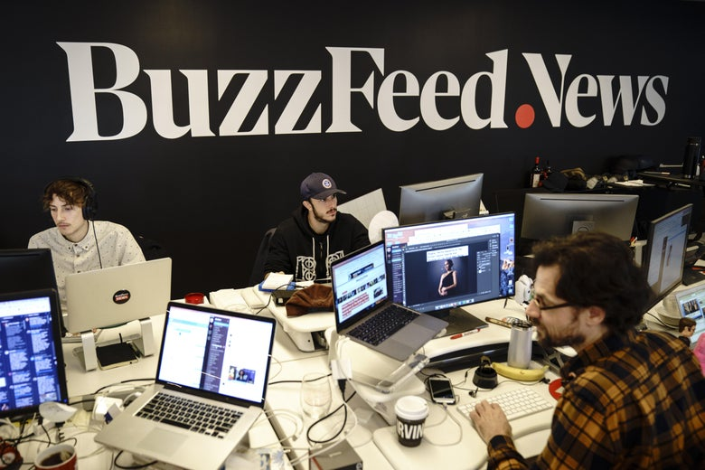 Members of the BuzzFeed News team work at their desks at BuzzFeed headquarters, December 11, 2018 in New York City.